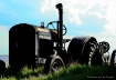 old tractor in fi...
