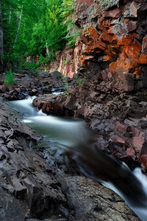 'Secluded Orange Falls'
