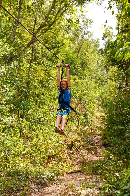 Rebecca on the zip line at Hidden Worlds - ID: 9052388 © Sharon E. Lowe
