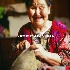 © Cheryl  A. Moseley PhotoID# 9183889: Eskimo Woman sewing animal skin into garment
