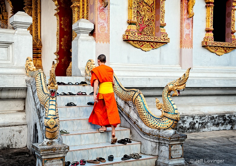 Luang Prabang, Laos, Monk on Stairs - ID: 10505628 © Jeff Lovinger