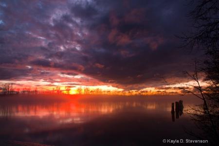 Sunset Over Misty River