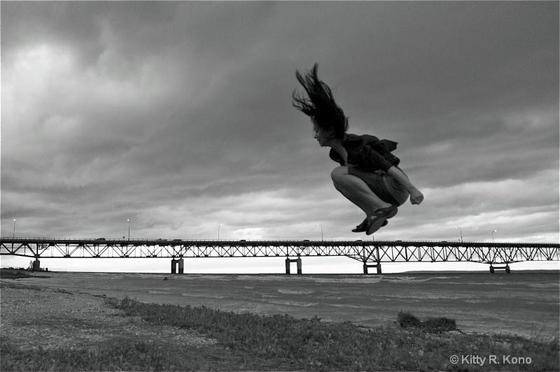 Yumiko Jumping Over the Mackinaw Island Bridge - ID: 12013822 © Kitty R. Kono
