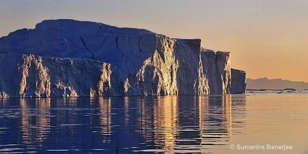giant icebergs in the midnight sun  greenland