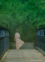 Woman Walking Across Bridge