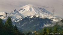 mt rainier is blanketed by a cloud