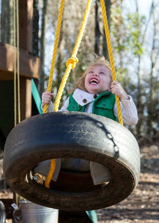 Joy On The Tire Swing