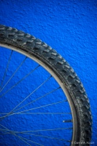 Bicycle Wheel against Blue Wall, Burano, Italy