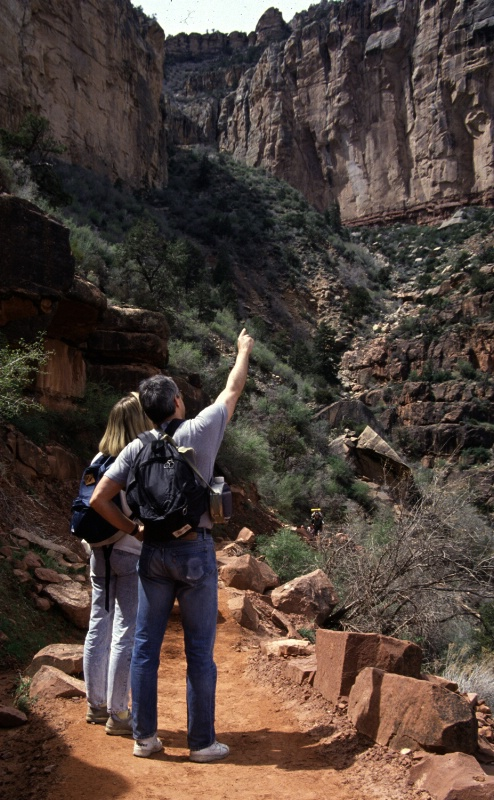 Couple hiking Grand Canyon NP, AZ