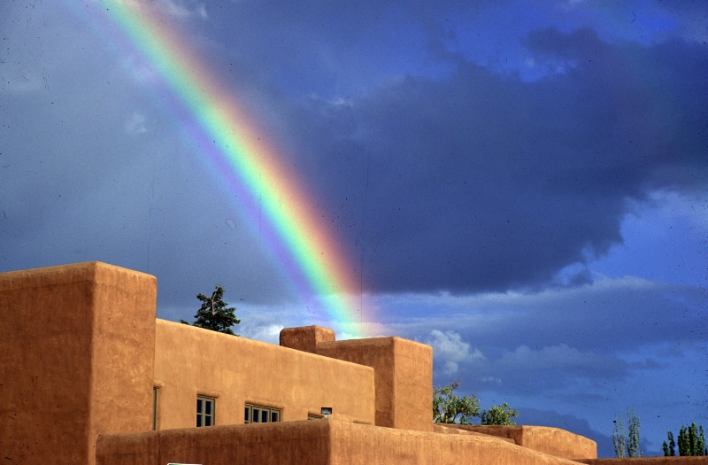 Rainbow over adobe building in Santa Fe, NM