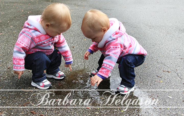 Little girl and little puddles.