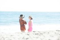 Girls chatting on the beach.