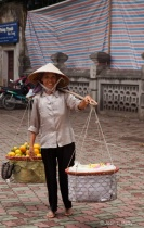 Woman in Vietnam Carrying Load