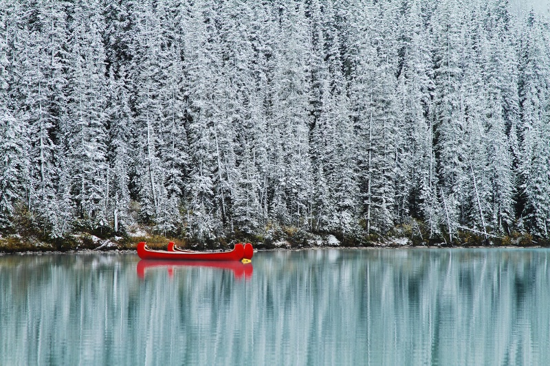 First snow and the red canoes