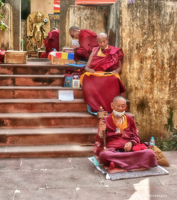 Budhist Monks At Prayer