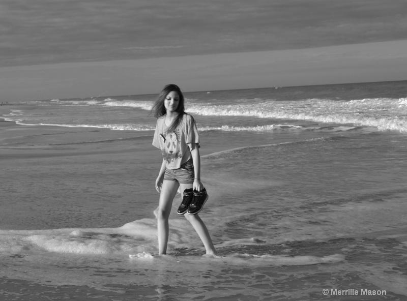 Harley kicking up the surf - ID: 14346660 © Merrille Mason