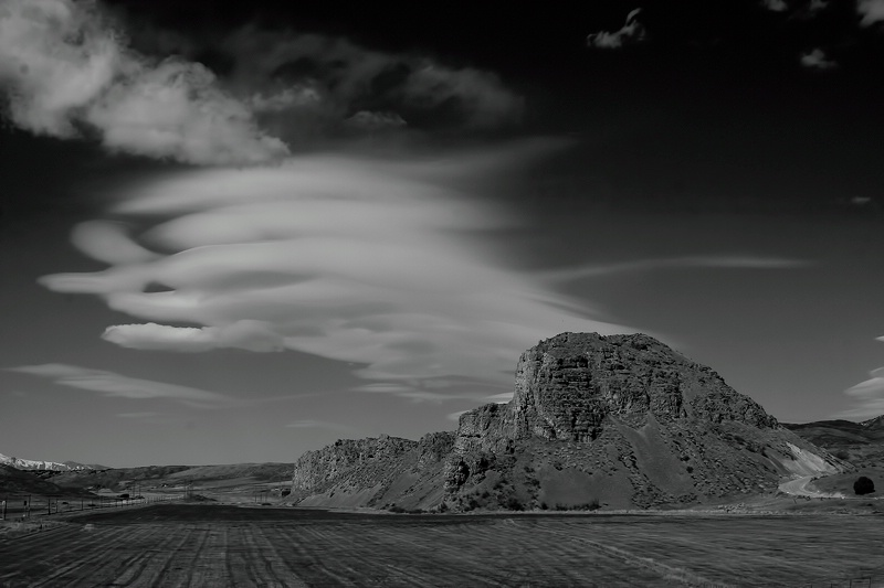 Clouds over rock formation