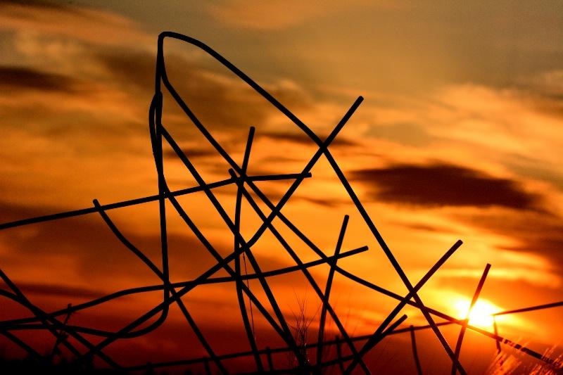 Mangled Fence at Sunset