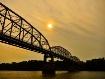 Sunset over bridg...