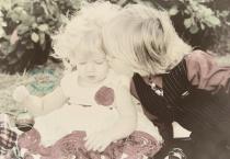 Sibling stealing a kiss