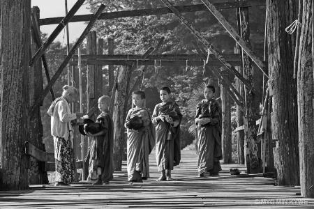 Morning alms on the bridge.