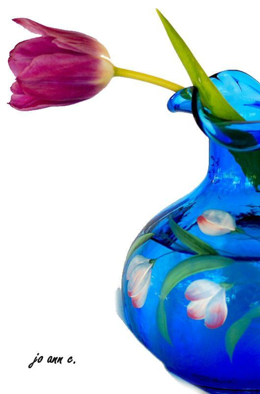 Tulips in a Blue Vase.....