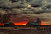Two Old Barn Houses In The Springtime Sunset