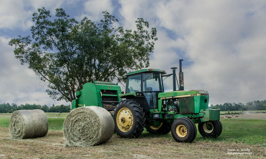 Tractor and 2 bales of hay