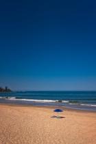 Blue Parasol On A Beach