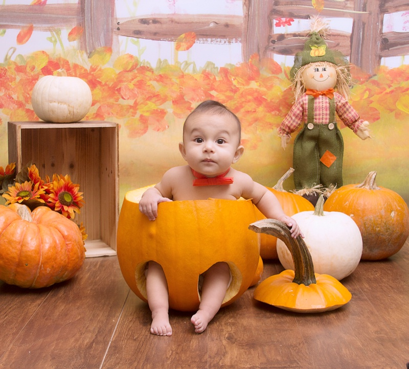 *Baby in a Pumpking*
