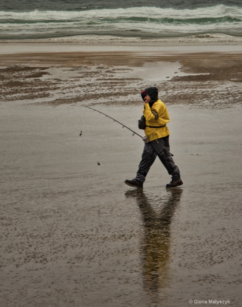 Fisherman in the rain, Maine, USA