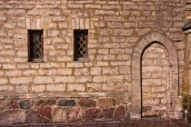 Two Windows And A Blocked Doorway