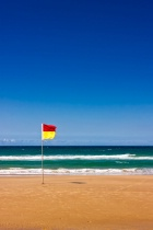 Lonely Life Saver Flag On Australian Beach
