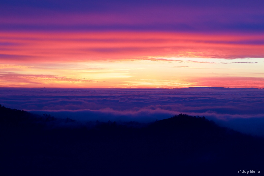 Brilliant Sunset over the clouds
