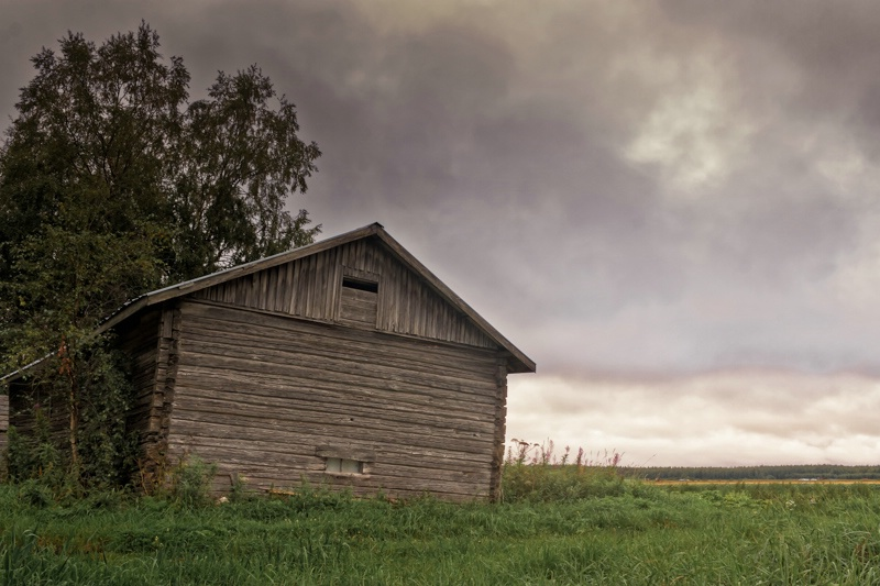 Dramatic Clouds Over The Barn House