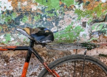 Used Bicycle seat again a decayed wall