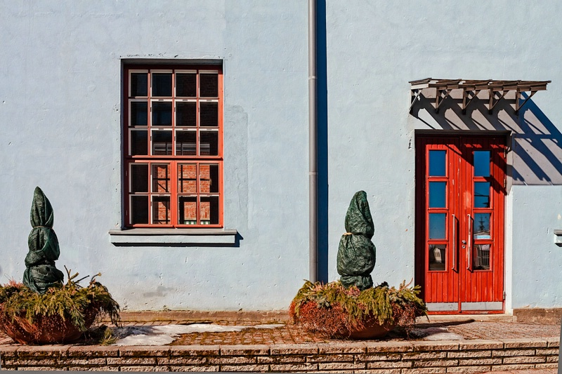 Red Window And Door On A Blue Wall