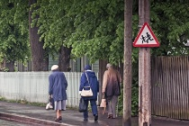 Three Seniors Walking Back From The Shops