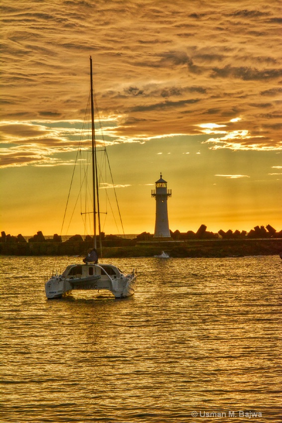 A Lighthouse and a Catamaran