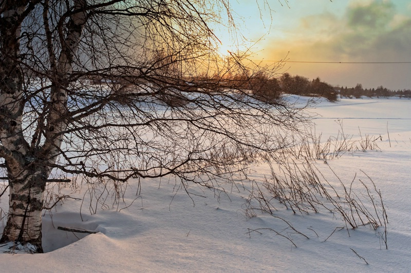 Dramatic Sunset Over The Icy River