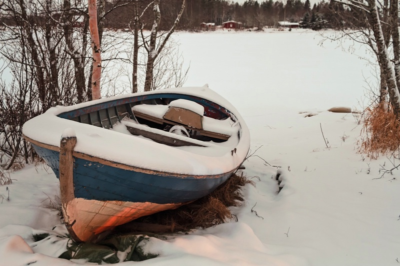 Old Fishing Boat Covered With Snow
