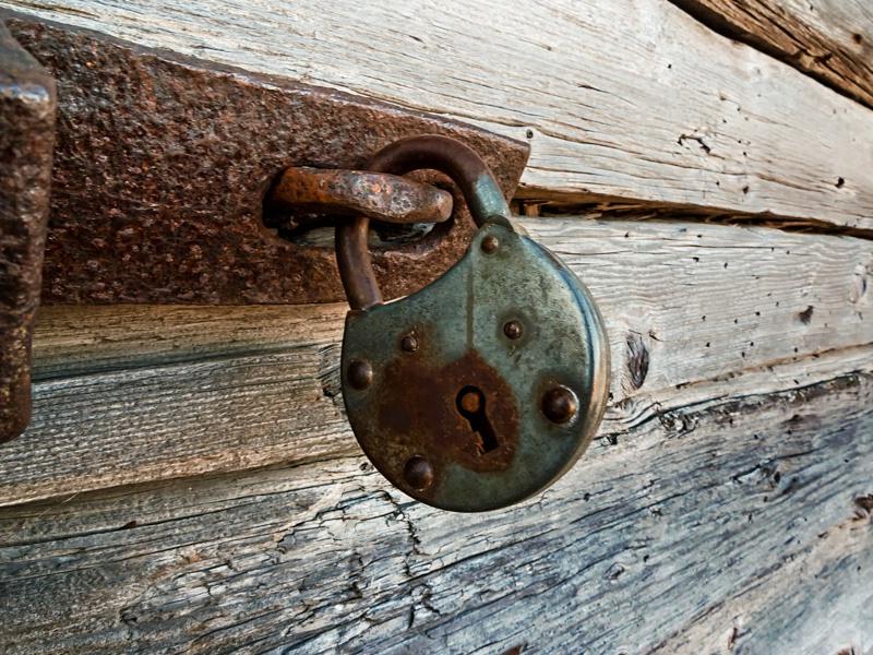 Old Lock On A Wooden Door