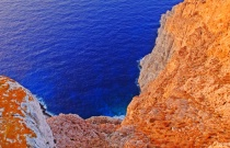 Sunbathed rocks at the edge. Folegandros island.